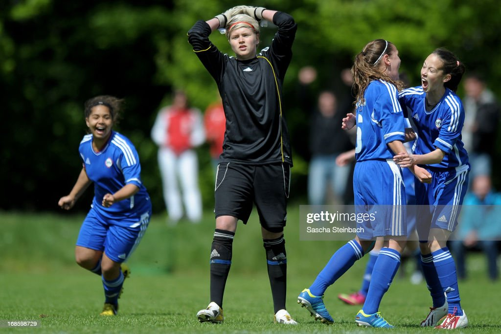 The team of Baden celebrates while the goalkeeper of Brandenburg looks dejected during the U15 Federal Cup of the German Football Association DFB at Sports Academy Wedau on May 12, 2013 in Duisburg, Germany.