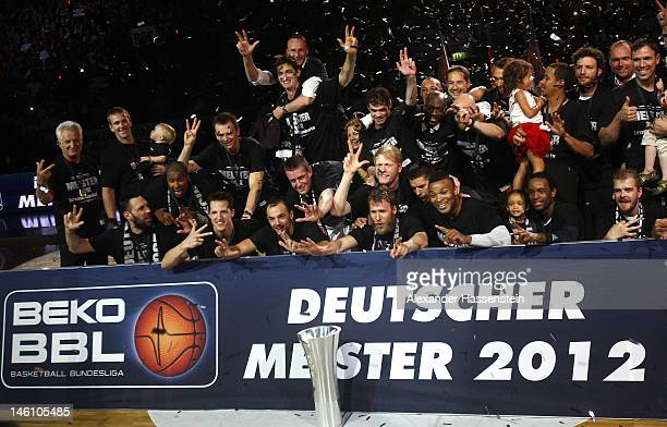 The team of Bamberg celebrate the German Championships 2012 with Champions Trophy after winning game 3 of the Beko BBL finals between Brose Baskets...