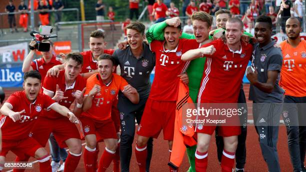 The team of Bayern celebrates after winning the U19 German Championship Semi Final second leg match between FC Schalke and FC Bayern at Lohrheide...