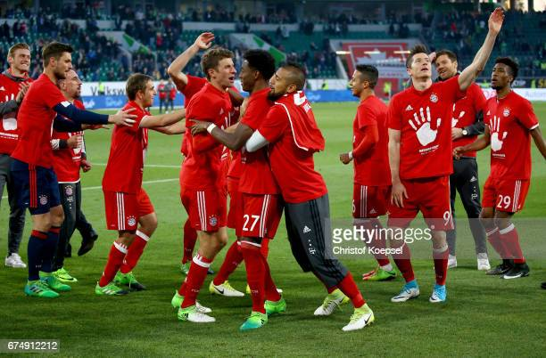The team of Bayern celebrates winning the German Championship after winning 60 the Bundesliga match between VfL Wolfsburg and Bayern Muenchen at...