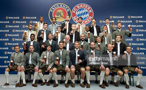 The team of Bayern Muenchen attend the FC Bayern Muenchen Paulaner photo shoot in traditional Bavarian lederhosen at Bayern Muenchen's headquarters...