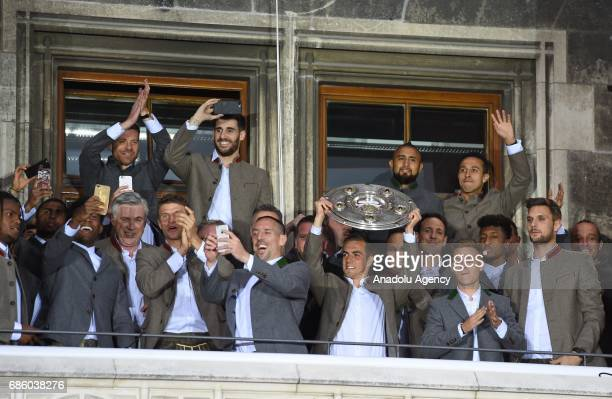 The team of Bayern Munich celebrates winning the German soccer championship on a balcony of the town hall in Munich Germany on May 20 2017
