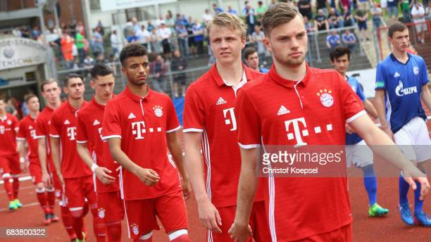 The team of Bayern with Felix Goetze enter the pitch prior to the U19 German Championship Semi Final second leg match between FC Schalke and FC...
