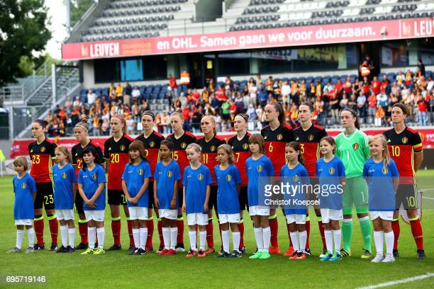 The team of Belgium stand for the national anthem prior to the Women's International Friendly match between Belgium and Japan at Stadium Den Dreef on...