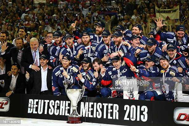 The team of Berlin celebrate after winning in game four of the DEL final playoffs between Eisbaeren Berlin and Koelner Haie at o2world Berlin on...