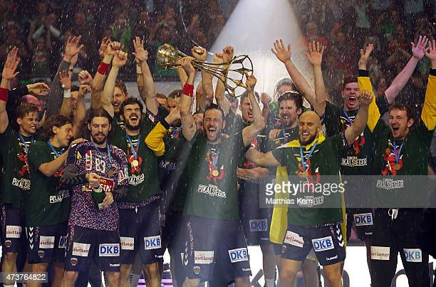 The team of Berlin celebrate with the trophy after winning the EHF Cup 2015 final match between Fuechse Berlin and HSV Handball at Max Schmeling hall...