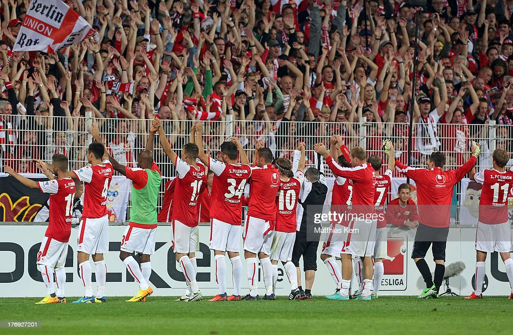 The team of Berlin celebrate with their supporters after winning the Second Bundesliga match between 1.FC Union Berlin and Fortuna Duesseldorf at Stadion an der Alten Foersterei on August 19, 2013 in Berlin, Germany.