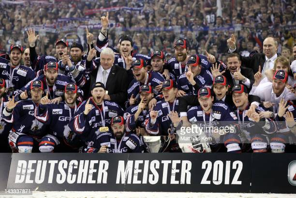 The team of Berlin pose with the Cup after winning the DEL final match between EHC Eisbaeren Berlin and Adler Mannheim at O2 World stadium on April...