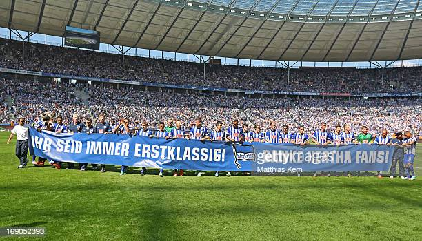 The team of Berlin thanks their supporters with a big banner after winning the championship after the Second Bundesliga match between Hertha BSC...