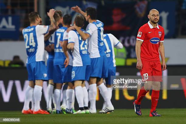 The team of Bochum celebrates the first goal and Philipp Riese of Heidenheim looks dejected during the Second Bundesliga match between VfL Bochum and...