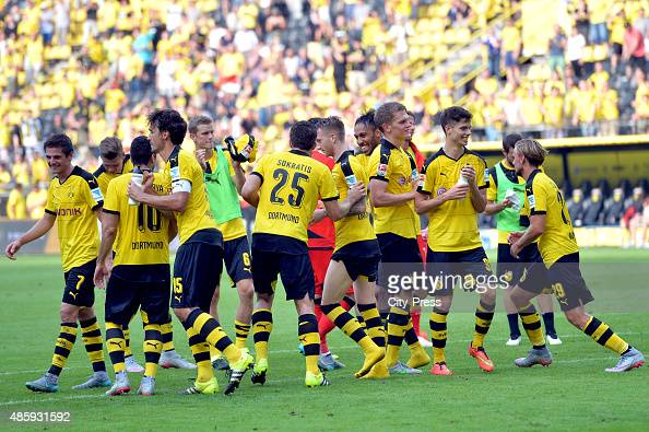 The team of Borussia Dortmund acknowledges the fans during the game between Borussia Dortmund and Hertha BSC on August 30 2015 in Dortmund Germany