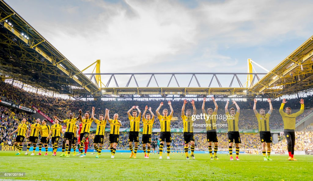 The team of Borussia Dortmund celebrates after winning the Bundesliga match between Borussia Dortmund and TSG 1899 Hoffenheim at Signal Iduna Park on May 6, 2017 in Dortmund, Germany.
