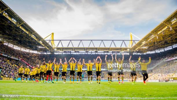 The team of Borussia Dortmund celebrates after winning the Bundesliga match between Borussia Dortmund and TSG 1899 Hoffenheim at Signal Iduna Park on...
