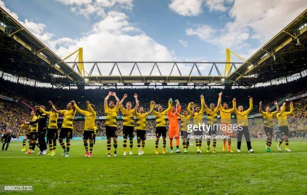 The team of Borussia Dortmund celebrates the win after the final whistle during the Bundesliga match between Borussia Dortmund and Werder Bremen at...