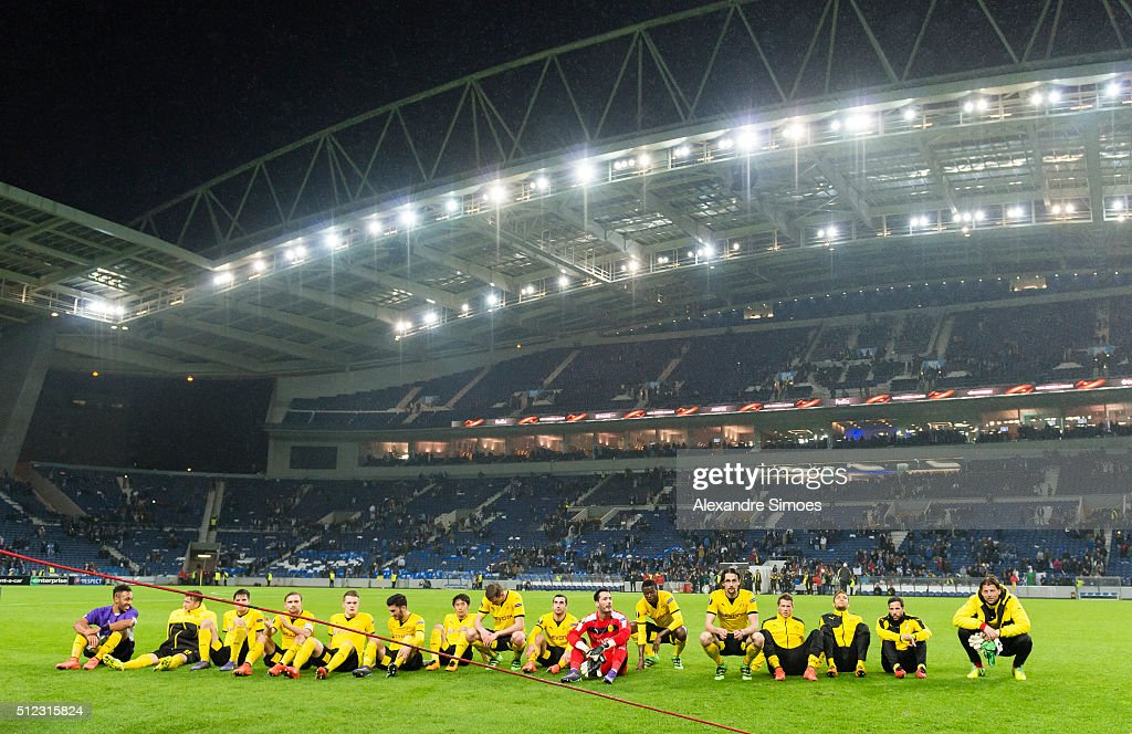 The team of Borussia Dortmund celebrates the win together with their fans after the final whistle during the UEFA Europa League Round of 32 Second Leg match between FC Porto and Borussia Dortmund at Estadio do Dragao on February 25, 2016 in Porto, Portugal.