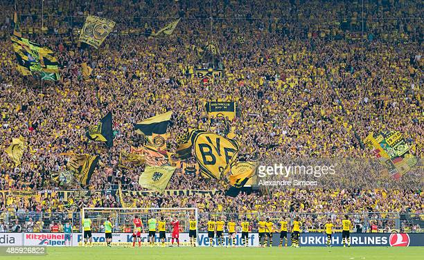 The team of Borussia Dortmund celebrates the win with their fans after the final whistle during the Bundesliga match between Borussia Dortmund and...