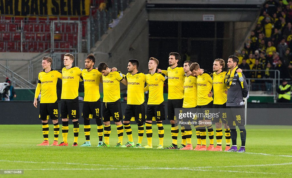 The team of Borussia Dortmund during the minute's silence prior to the DFB Cup match between VfB Stuttgart and Borussia Dortmund at Mercedes-Benz Arena on February 09, 2016 in Stuttgart, Germany.