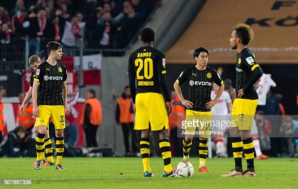 The team of Borussia Dortmund looks dejected after conceding a goal during the Bundesliga match between 1 FC Koeln and Borussia Dortmund at...