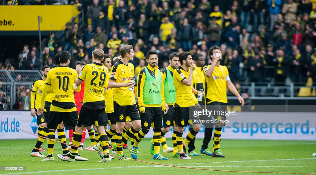 The team of Borussia Dortmund looks happy after the final whistle during the Bundesliga match between Borussia Dortmund and VfL Wolfsburg at Signal Iduna Park on April 30, 2016 in Dortmund, Germany.
