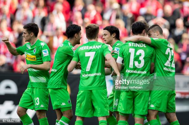 The Team of Borussia Moenchengladbach celebrate after Lars Stindl scores their first goal during the Bundesliga Match between 1FSV Mainz 05 and...