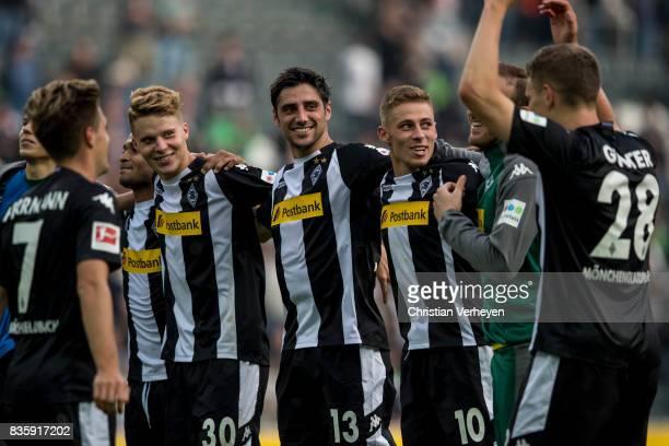 The team of Borussia Moenchengladbach celebrate after the Bundesliga match between Borussia Moenchengladbach and 1 FC Koeln at BorussiaPark on August...