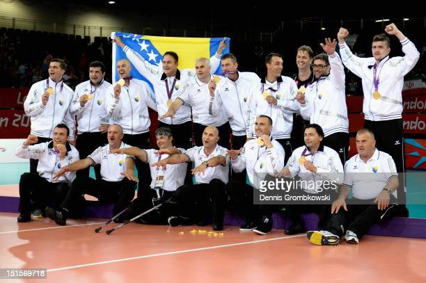 The team of Bosnia and Herzegovina celebrates after winning the gold in the Men's Sitting Volleyball competition on day 10 of the London 2012...