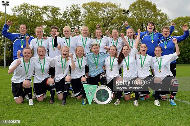 The team of Brandenburg celebrate after winning their U16 Girl's Federal Cup match against Niedersachsen at Sportschule Wedau on April 15 2014 in...