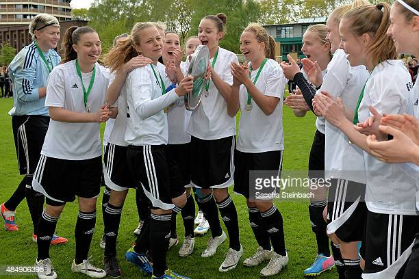 The team of Brandenburg celebrate after winning their U16 Girl's Federal Cup match against Niedersachsen at Sportschule Wedau on April 15 2014 in...