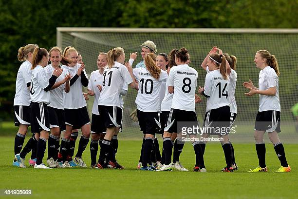 The team of Brandenburg celebrates after winning their U16 Girl's Federal Cup match against Niedersachsen at Sportschule Wedau on April 15 2014 in...