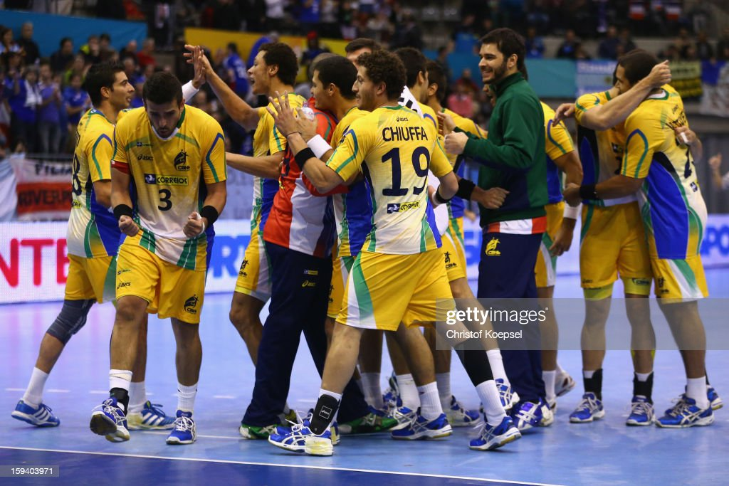 The team of Brazil celebrates the 24-20 victory after the premilary group A match between Brasil and Argentina and Montenegro at Palacio de Deportes de Granollers on January 13, 2013 in Granollers, Spain. The match between Brasil and Argentina ended 24-20.