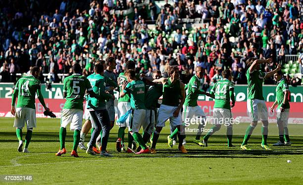 The team of Bremen celebrate after the Bundesliga match between SV Werder Bremen and Hamburger SV at Weserstadion on April 19 2015 in Bremen Germany