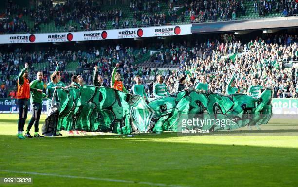 The team of Bremen celebrate victory after the Bundesliga match between Werder Bremen and Hamburger SV at Weserstadion on April 16 2017 in Bremen...