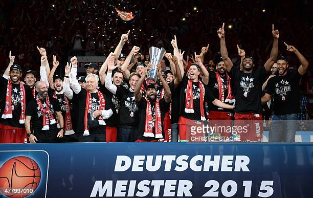 The team of Brose Baskets Bamberg celebrate the German basketball championship title after the basketball Bundesliga fifth final play off match Brose...