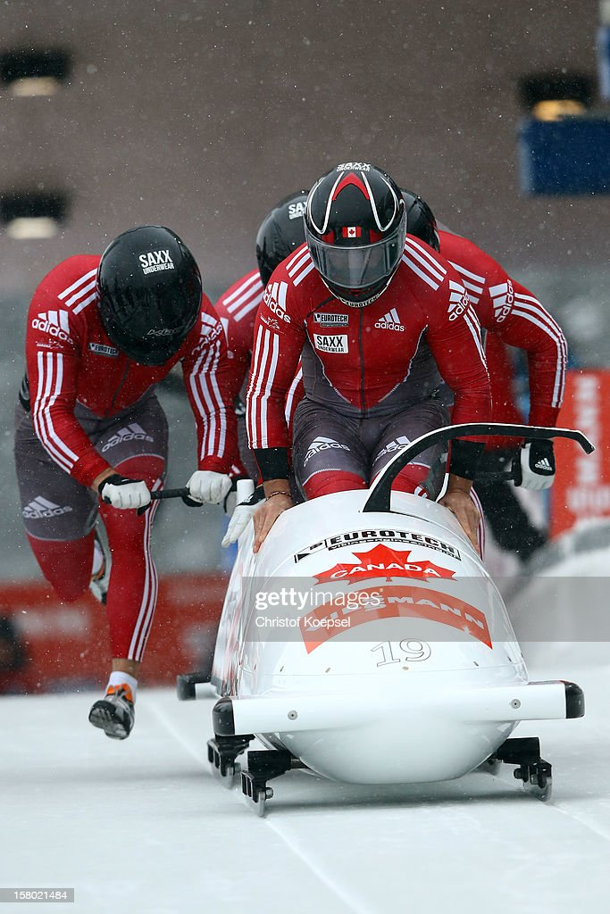 The team of Canada 1 with Lyndon Rush, Cody Sorensen, Jesse Lumsden and Neville Wirght sprints during the four men's bob competition during the FIBT Bob & Skeleton World Cup at Bobbahn Winterberg on December 9, 2012 in Winterberg, Germany.