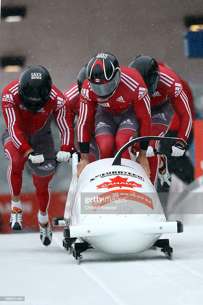 The team of Canada 2 with Chris Spring, Luke Demetre, Ben Coakwell and Adam Rosenke sprints during the four men's bob competition during the FIBT Bob & Skeleton World Cup at Bobbahn Winterberg on December 9, 2012 in Winterberg, Germany.