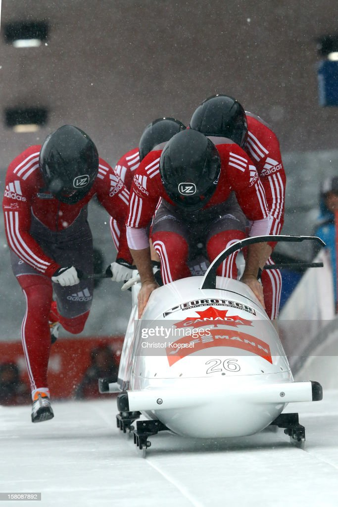The team of Canada 3 with Justin Kripps, James McNaughton, Giguere Samuel and Jean-Nicolas Carriere sprint during the four men's bob competition during the FIBT Bob & Skeleton World Cup at Bobbahn Winterberg on December 9, 2012 in Winterberg, Germany.