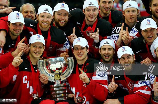 The team of Canada celebrate with the trophy after winning against Russia during the IIHF World Championship gold medal match between Canada and...