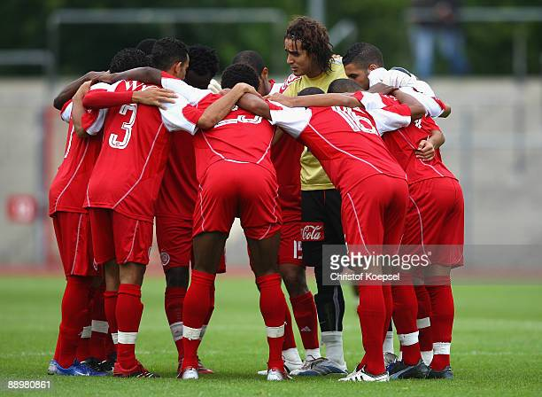 The team of Casablanca comes together before the Zayon Cup match between Al Ahly and Wydad AC Casablanca at the Lorheide stadium on July 11 2009 in...