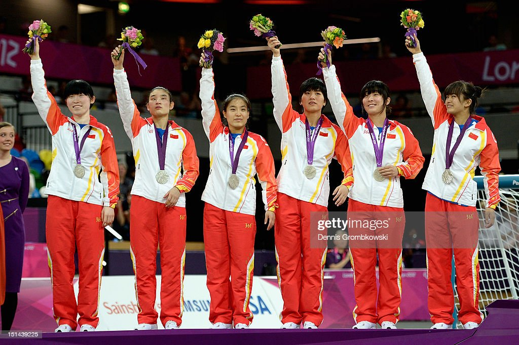 The team of China poses on the podium after winning the silver in the Women's Team Goalball competition on day 9 of the London 2012 Paralympic Games at The Copper Box on September 7, 2012 in London, England.
