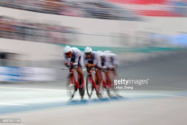 The team of Chinese Taibei competes in Cycling Track Men's Team Pursuit Qualifying during the 2014 Asian Games at Incheon International Velodrome on...