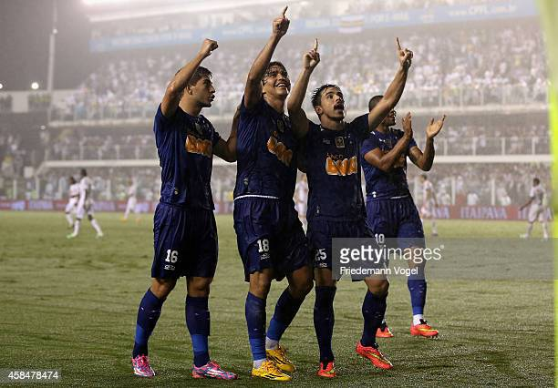 The team of Cruzeiro celebrates scoring the second goal during the match between Santos and Cruzeiro for Copa do Brasil 2014 at Vila Belmiro Stadium...