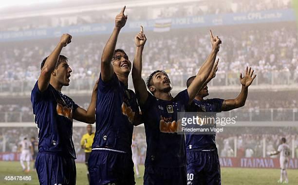 The team of Cruzeiro celebrates scoring the second goal during the match between Santos and Cruzeiro for Copa do Brasil 2014 at Vila Belmiro Stadium...