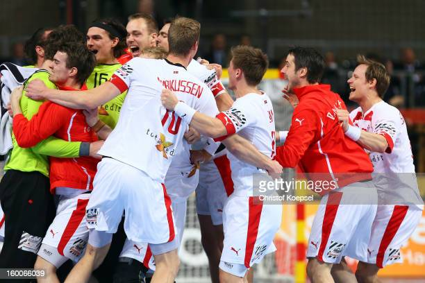 The team of Denmark celebrates the 3024 victory after Men's Handball World Championship 2013 semi final match between Denmark and Croatia at Palau...