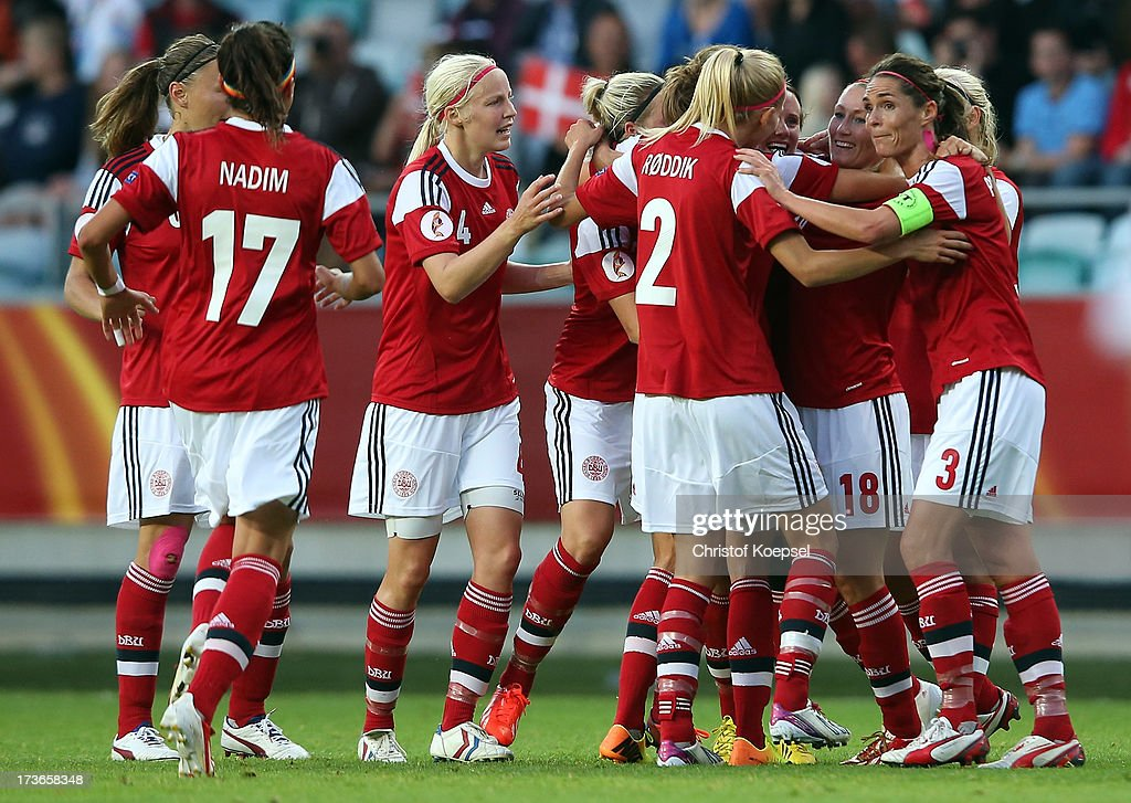 The team of Denmark celebrates the first goal of Mia Brogaard (hidden) during the UEFA Women's EURO 2013 Group A match between Denmark and Finland at Gamla Ullevi Stadium on July 16, 2013 in Gothenburg, Sweden.