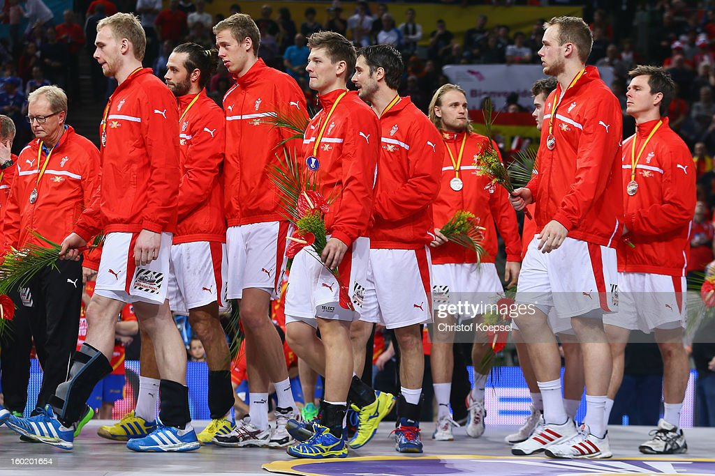 The team of Denmark leaves the podium dejected after losing the Men's Handball World Championship 2013 final match between Spain and Denmark at Palau Sant Jordi on January 27, 2013 in Barcelona, Spain.