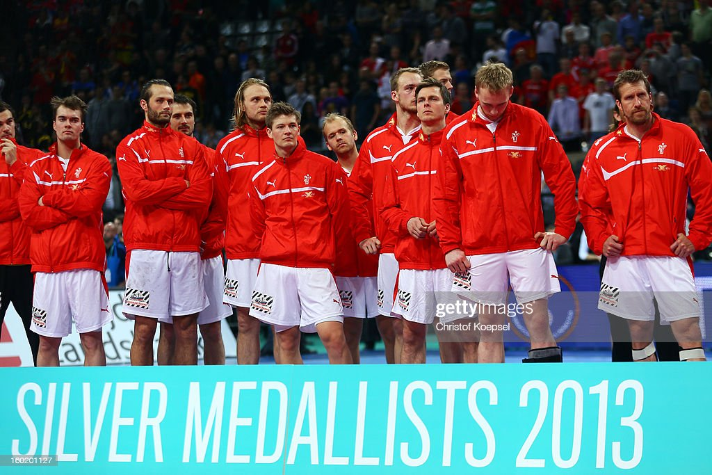 The team of Denmark look dejected after losing the Men's Handball World Championship 2013 final match between Spain and Denmark at Palau Sant Jordi on January 27, 2013 in Barcelona, Spain.