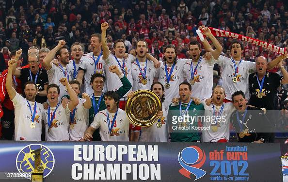 The team of Denmark pose with the EHF tropy on the podium after winninbg 2119 the Men's European Handball Championship final match between Serbia and...