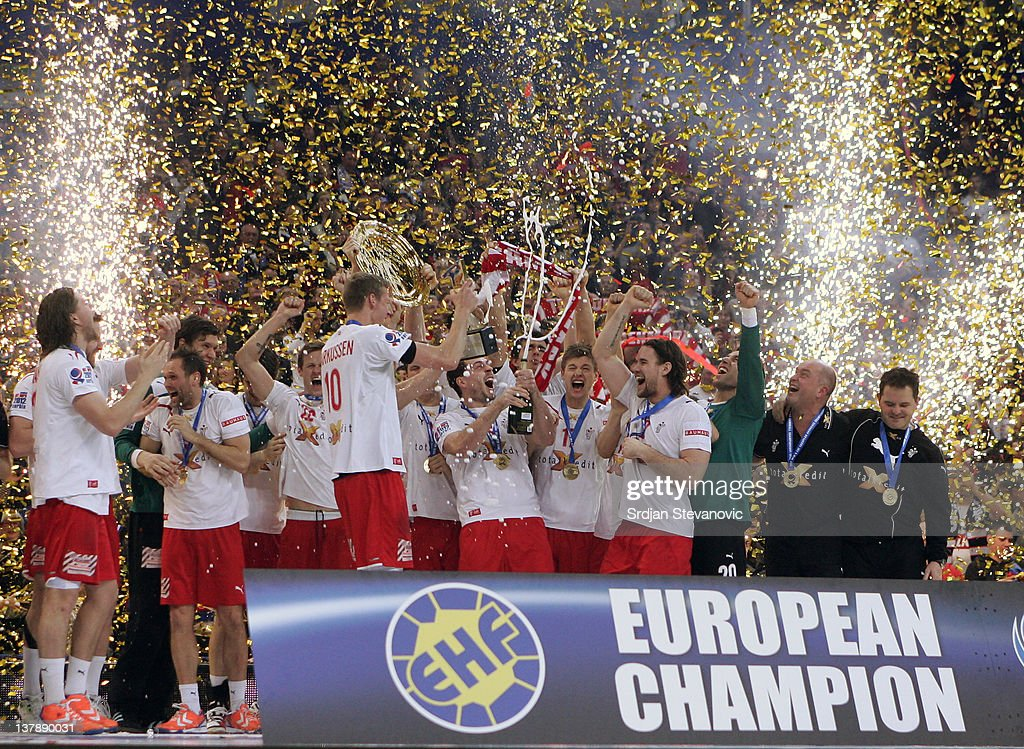 The team of Denmark pose with the EHF tropy on the podium after winning 21-19 the Men's European Handball Championship final match between Serbia and Denmark at Beogradska Arena on January 29, 2012 in Belgrade, Serbia.