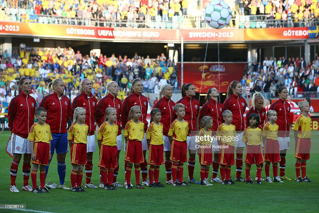 The team of Denmark stands up for the national anthem prior to the UEFA Women's EURO 2013 Group A match between Sweden and Denmark at Gamla Ullevi Stadium on July 10, 2013 in Gothenburg, Sweden. The match between Sweden and Denmark ended 1-1.