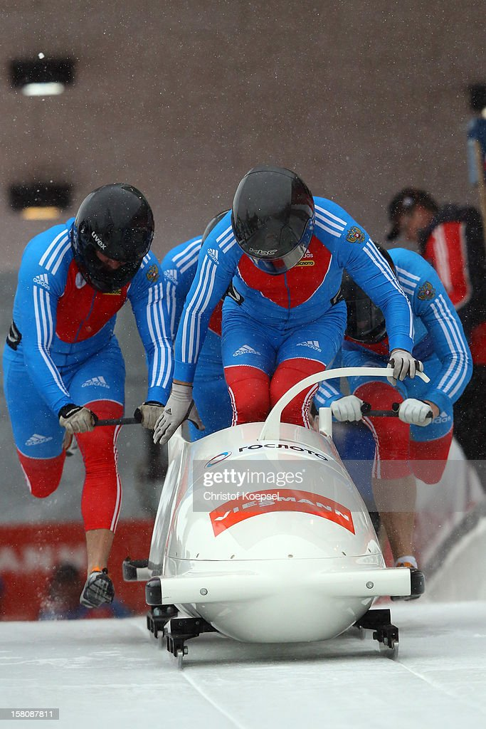 The team of Dmitry Abramovitch, Petr Moiseev, Dmitry Stepushkin and Aleksei Pushkarev of Russia 2 sprint during the four men's bob competition during the FIBT Bob & Skeleton World Cup at Bobbahn Winterberg on December 9, 2012 in Winterberg, Germany.